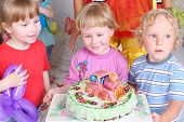 pic of loco  - Three happy kids and birthday cake with locomotive at funny children party - JPG