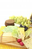 stock photo of grated radish  - Slices of cheese with grapes radishes and bread - JPG