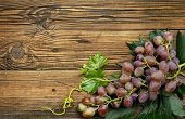 image of basement  - Bunch of grapes on old weathered wood - JPG