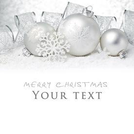 stock photo of ribbon decoration  - Christmas balls with ribbon on snow - JPG