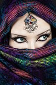 picture of eastern culture  - Portrait of beautiful woman wrapped in scarf with Indian tikka - JPG
