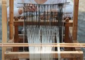 stock photo of handloom  - Front view of an old handloom weaving machine - JPG