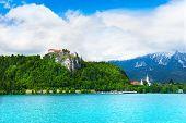 foto of castle  - Bled Slovenia castle and village in front of Alp castles - JPG