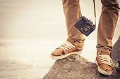 stock photo of swag  - Feet man and vintage retro photo camera outdoor Travel Lifestyle vacations concept