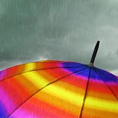 Colorful umbrella top with heavy rain and clouds