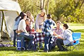 stock photo of 11 year old  - Two Families Enjoying Camping Holiday In Countryside - JPG