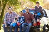 Fathers With Sons Sitting In Truck On Camping Holiday