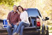 foto of pick up  - Couple Sitting In Pick Up Truck On Camping Holiday - JPG