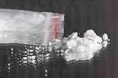 stock photo of crystal meth  - Cocaine powder pile and packet on mirror - JPG