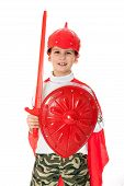 pic of valiant  - Young Boy Dressed Like a knight holding a sword and shield isolated on white - JPG