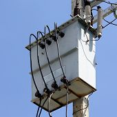 stock photo of transformer  - photo of  electric transformer on electric pole - JPG