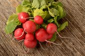 stock photo of radish  - Red radish placed on old wood texture - JPG
