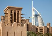 Burj Al Arab Behind Traditional Arabic Style Buldings in Madinat Jumeirah