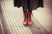 picture of woman boots  - Young woman in dress and retro boots is standing in the street - JPG