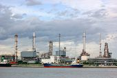 picture of ozone layer  - photo of  Oil refinery with thunderstorm background - JPG