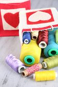 foto of lurex  - Colorful bobbins of thread  in bag - JPG