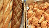picture of baguette  - french baguette and croissant bread on buffet line - JPG