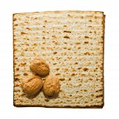 image of seder  - Matzo and three walnuts traditional Passover Seder food - JPG