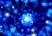 Background conceptual image with white snowflakes on blue background