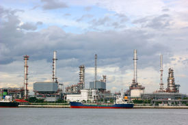 foto of ozone layer  - photo of  Oil refinery with thunderstorm background - JPG