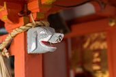 foto of inari  - Gray elephant head statue on the  stigmatic of colum in Fushimi Inari Taisha Shrin - JPG