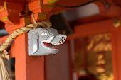 stock photo of inari  - Gray elephant head statue on the  stigmatic of colum in Fushimi Inari Taisha Shrin - JPG