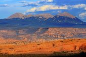 foto of southwest  - La Salle Mountains Yellow Rock Canyon Arches National Park Moab Utah USA Southwest. ** Note: Visible grain at 100%, best at smaller sizes - JPG