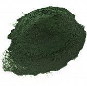 stock photo of algae  - Spirulina powder algae nutritional supplement heap surface close up top view - JPG