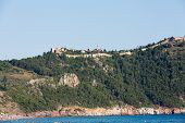 stock photo of cleopatra  - castle of Alanya built on rocks and beach of Cleopatra Antalya Turkey - JPG