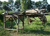 image of carriage horse  - Old Serbian wooden two wheel horse carriage standing as showpiece - JPG