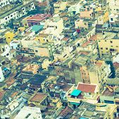 foto of trichy  - Vintage style image of colorful homes in crowded Indian city Trichy India Tamil Nadu - JPG