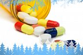 stock photo of pain-tree  - Frost and fir trees against spilled pills box - JPG