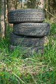 stock photo of illegal  - Old tires left in the woods - JPG