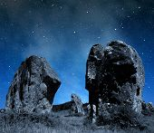 picture of megaliths  - Night sky above the megalithic monuments menhirs in Carnac - JPG
