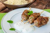 stock photo of kababs  - Beef kebab with coriander garlic couscous and mint dip - JPG