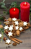 picture of nostalgic  - cinnamon cookies nuts and spieces with christmas decoration red candles and pine branch - JPG