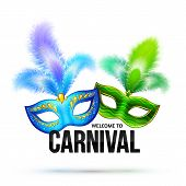 stock photo of feathers  - Bright vector carnival masks with feathers and black sign Welcome to Carnival - JPG