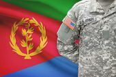 pic of eritrea  - American soldier with flag on background  - JPG