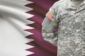 picture of qatar  - American soldier with flag on background  - JPG