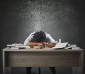 pic of fatigue  - Man tired of studying dreaming over books - JPG