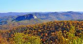 stock photo of asheville  - Looking Glass Rock as seen from the Blue Ridge Parkway in Western North Carolina during autumn - JPG