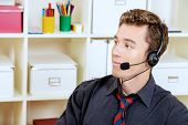 image of telemarketing  - Friendly smiling young man customer service worker - JPG