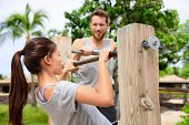 picture of supervision  - Fitness couple training on chin - JPG