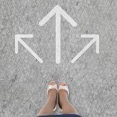 stock photo of crossroads  - Top view of businesswoman feet standing at crossroads - JPG
