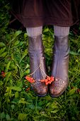 foto of rowan berry  - Red rowan berries on the girl - JPG