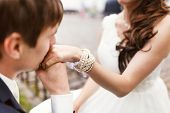 pic of hand kiss  - the groom kisses the hand of the bride on their wedding day - JPG
