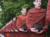 picture of recliner  - Statues of Buddhist monks collecting alms surround the massive Win Sein Taw Ya Buddha - JPG