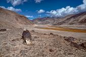 picture of arid  - Scenic arid valley in Pamir mountains in Tajikistan - JPG