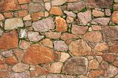 stock photo of mortar-joint  - Natural stone wall made of different stones - JPG