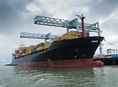 image of container ship  - Panamanian container ship being loaded in Boston harbor - JPG